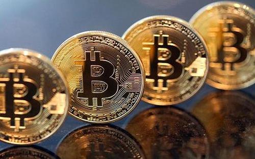 Trong mấy tháng gần đây, giá tiền ảo Bitcoin tăng mạnh liên tục - Ảnh: Getty/Bloomberg.